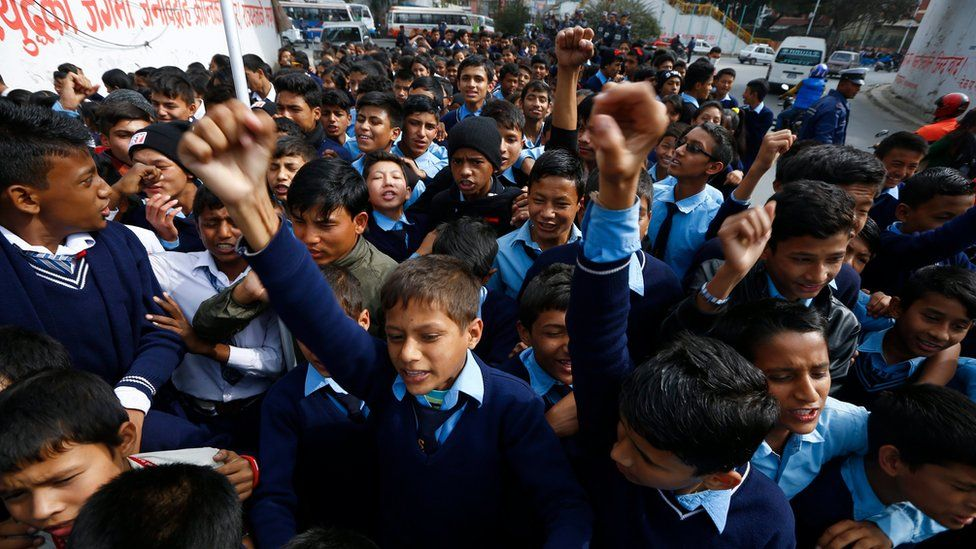 Nepalese school children shout anti India slogan during a protest rally in Kathmandu, Nepal. 24 November 2015