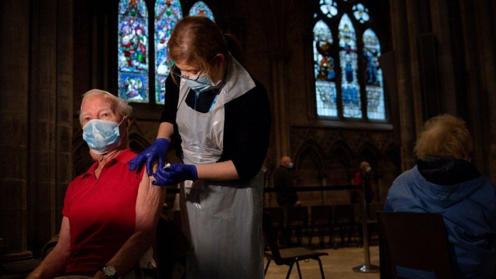 Geoffrey Beedle, 86, receives an injection of the Oxford/AstraZeneca coronavirus vaccine at Lichfield Cathedral