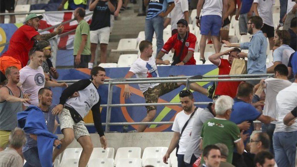 Fans clash inside the stadium