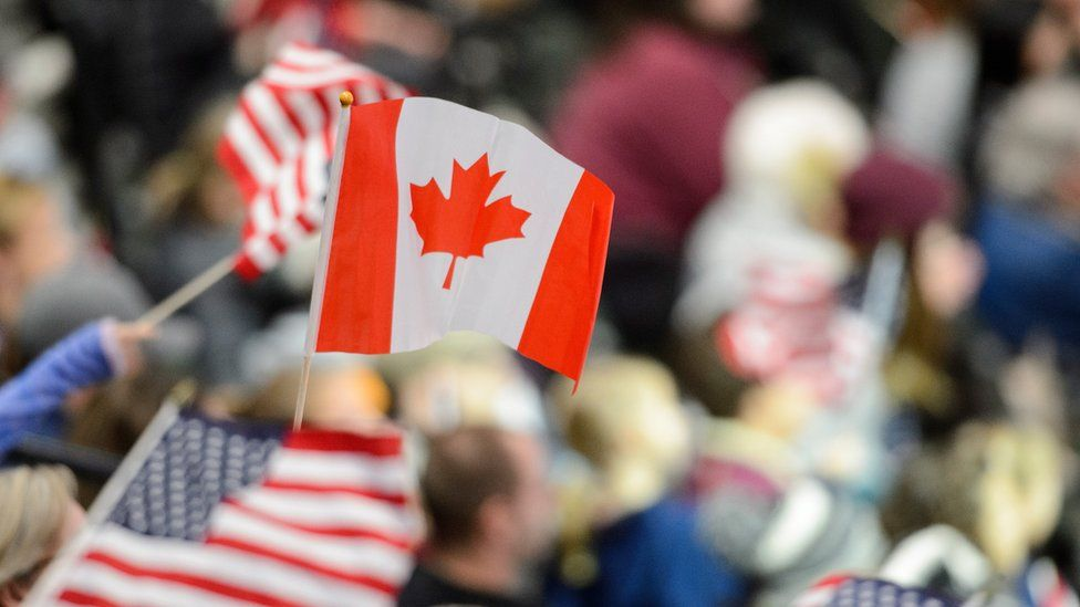 Canada flag and US flags