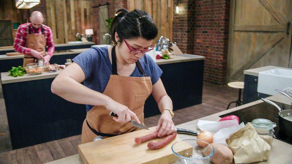 Suzie Arbuthnot chopping vegetables.