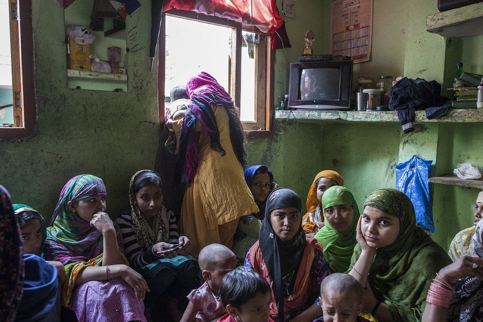 House in Khajuri Khas filled with women and children sat on the floor