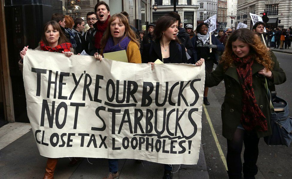 Protesters outside a Starbucks near Regent Street in 2012 in London, call for the company to pay more tax