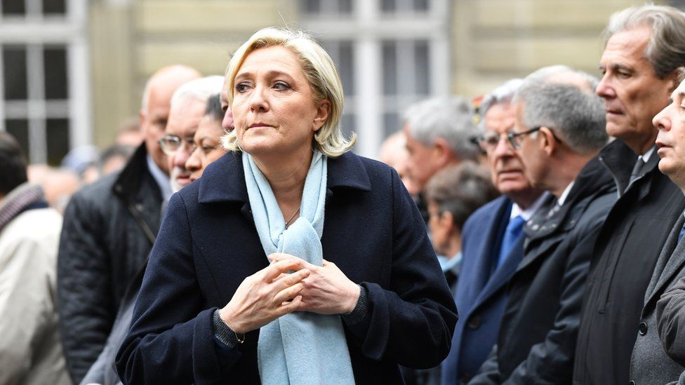 French presidential election candidate for the far-right Front National (FN) party, Marine Le Pen (L) attends a ceremony honouring the policeman killed by a jihadist in an attack on the Champs Elysees, on 25 April 2017 at the Paris prefecture building