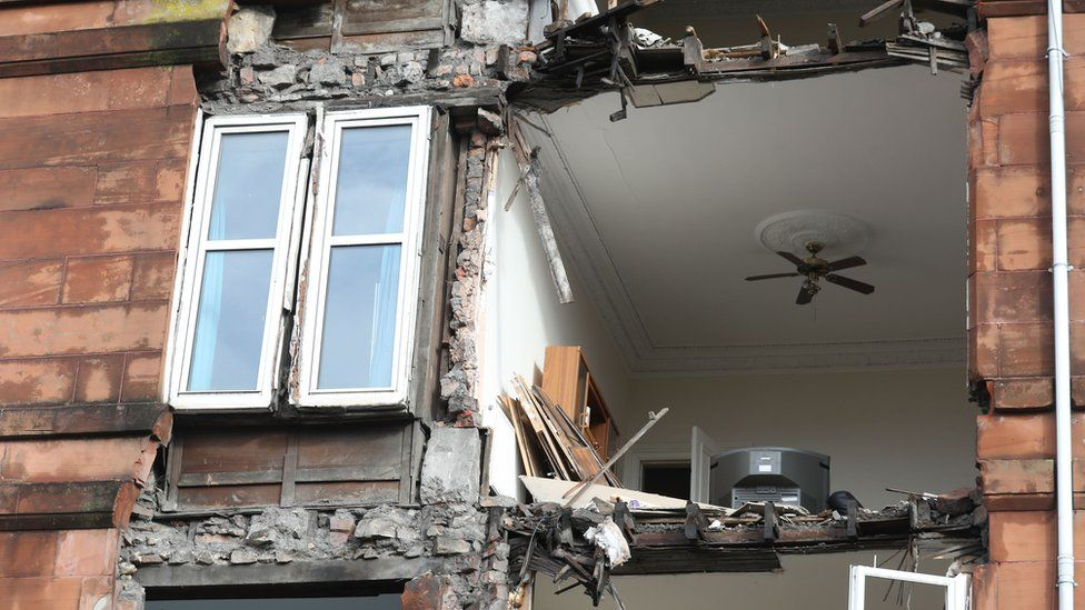 The front of a block of flat in Glasgow that had been due to be demolished was brought down