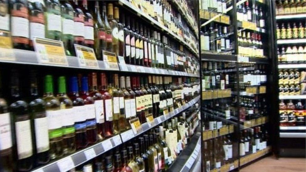 Bottles of alcohol on shop shelves