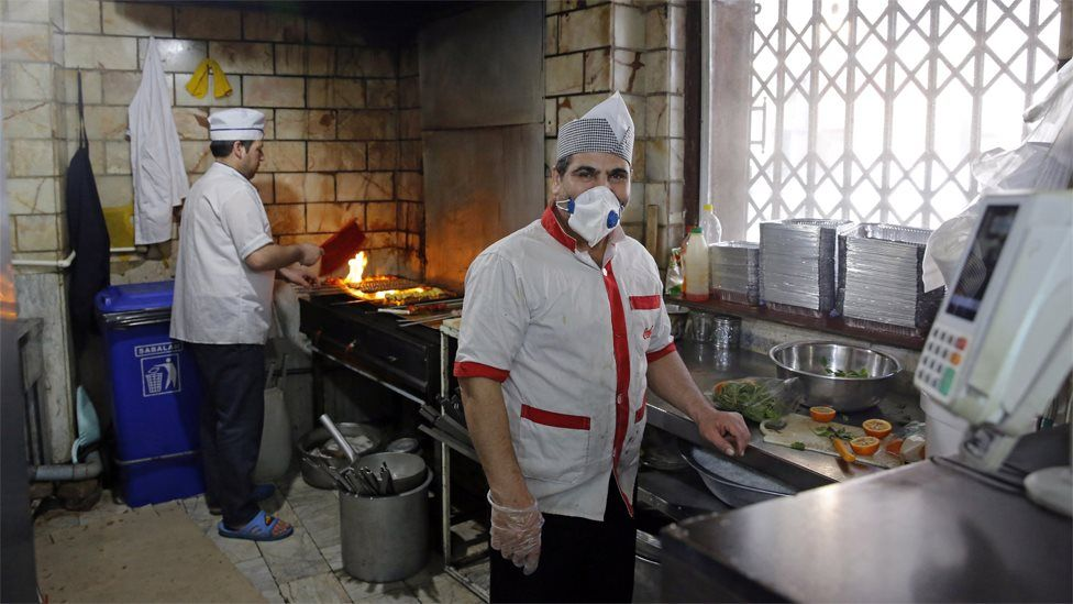 A chef wears a face mask at a restaurant in Tehran, Iran