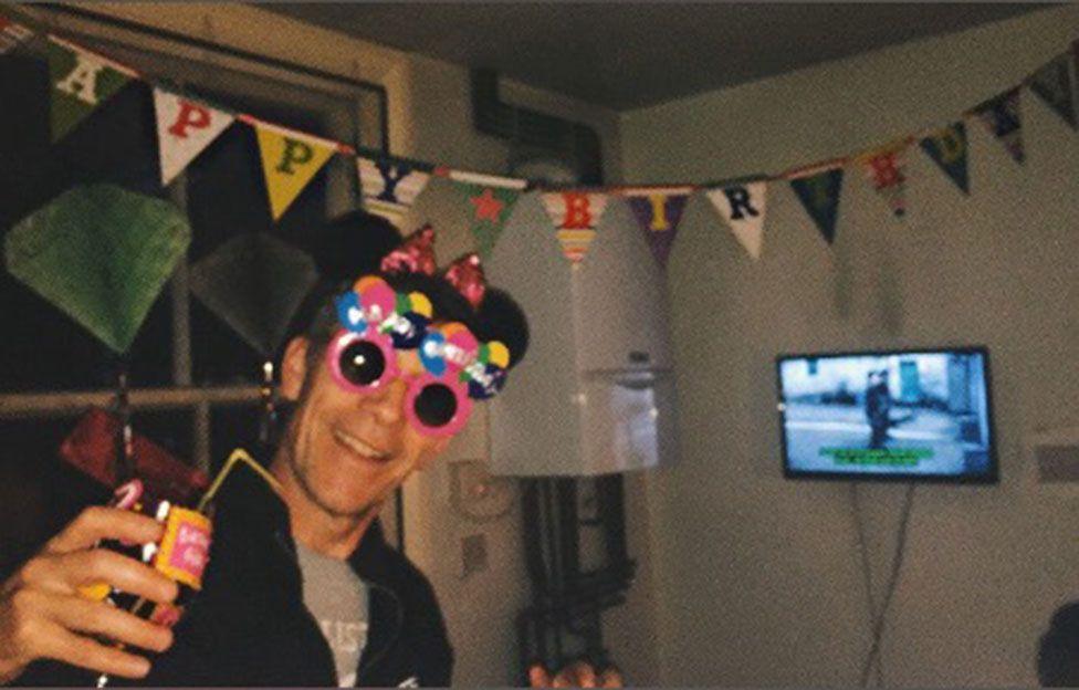 A man celebrates his birthday at home