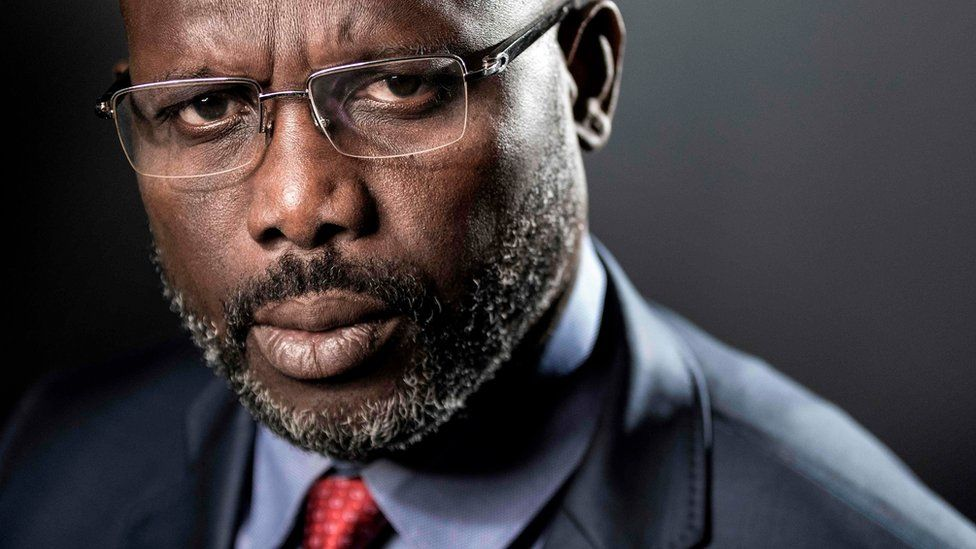 "Former football player and candidate in Liberia""s presidential elections, George Weah posing during a photo session in Paris."
