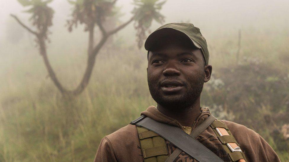 A ranger in the morning mist walks down Mount Nyiragongo in Virunga National Park