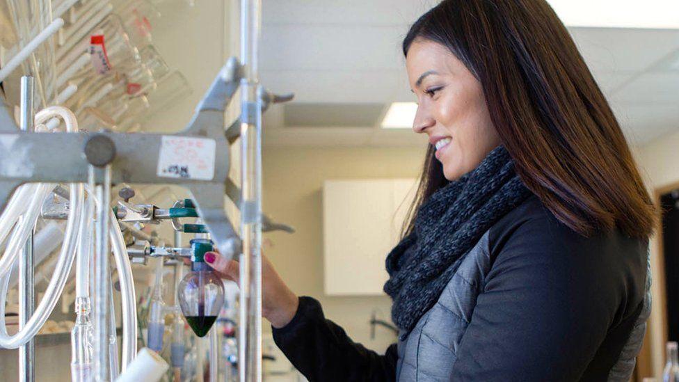 Woman checking wine sample