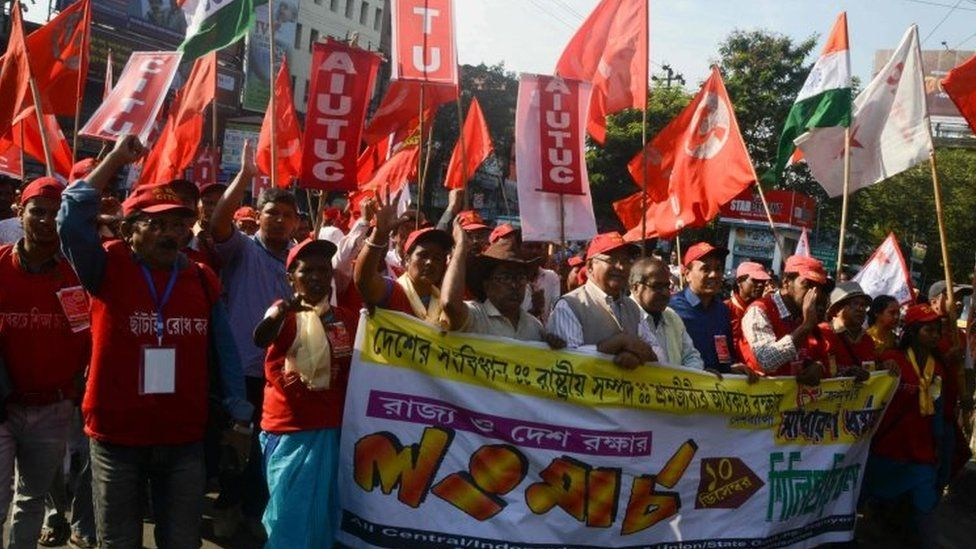 Indian activists of Left wing Trade unions along with others unions attend a rally organised to protest against the Citizenship Amendment Bill 2019 and National Register of Citizens (NRC) implemented by the Bharatiya Janata Party (BJP) led central government, in Siliguri on December 10, 2019. -