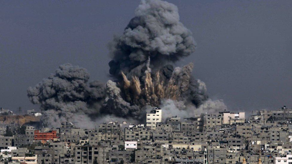 Clouds of smoke billow into the air following an Israeli military strike in Gaza City on 29 July 2014