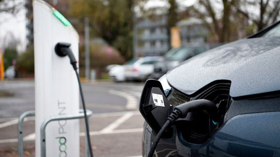 Electric vehicles (EV) charge at a charging station in east London on November 18, 2020