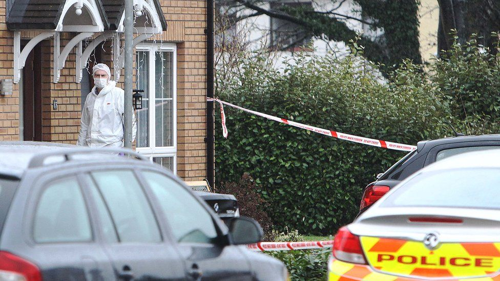 A forensic investigator at the house where Jayne Toal Reat was murdered