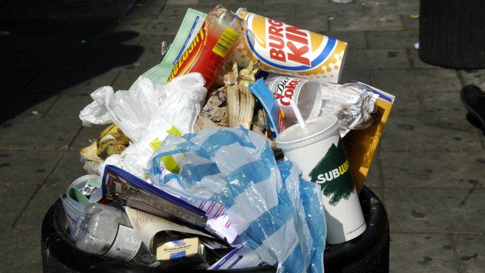 An overflowing rubbish bin in Tottenham Court Road, West End, London