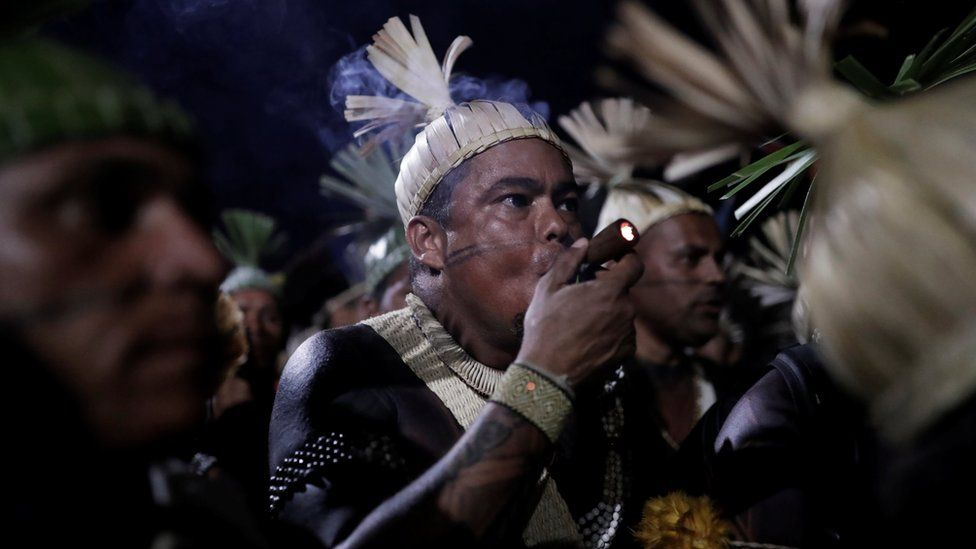 Indigenous men take part in a protest to defend indigenous land and cultural rights