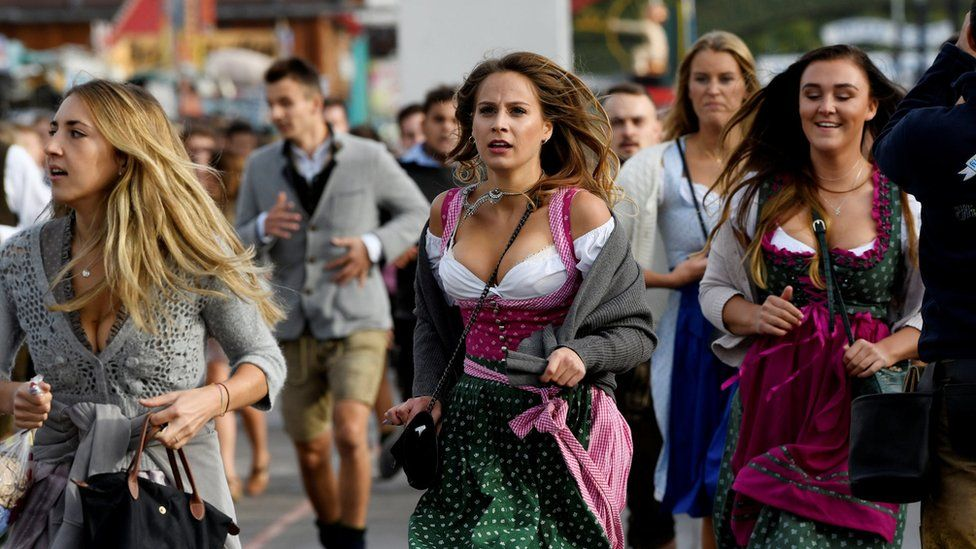 Visitors run to get a spot at the Oktoberfest