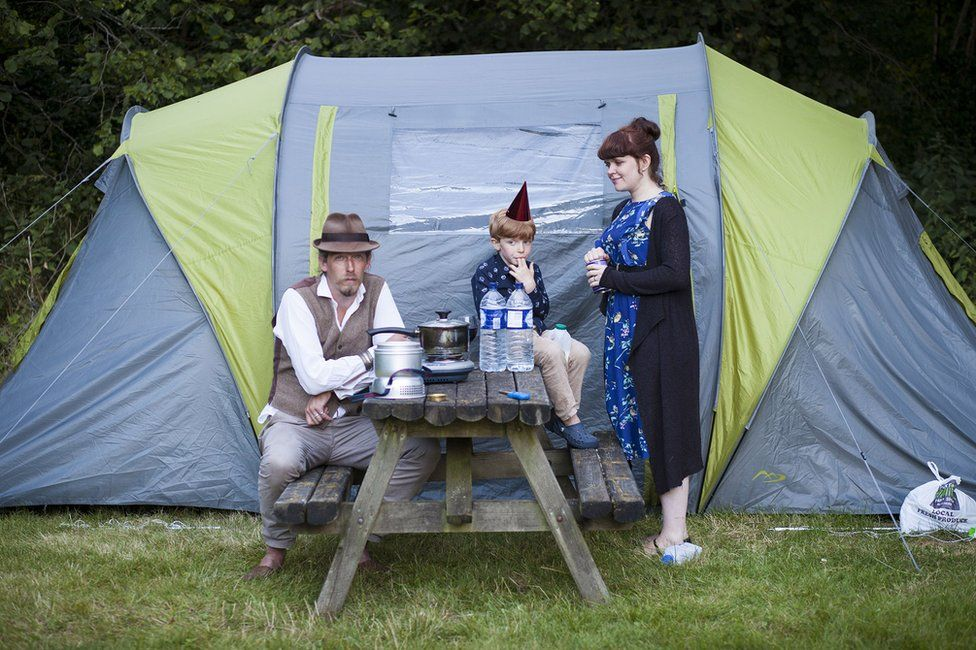Portrait of a family in front of a tent