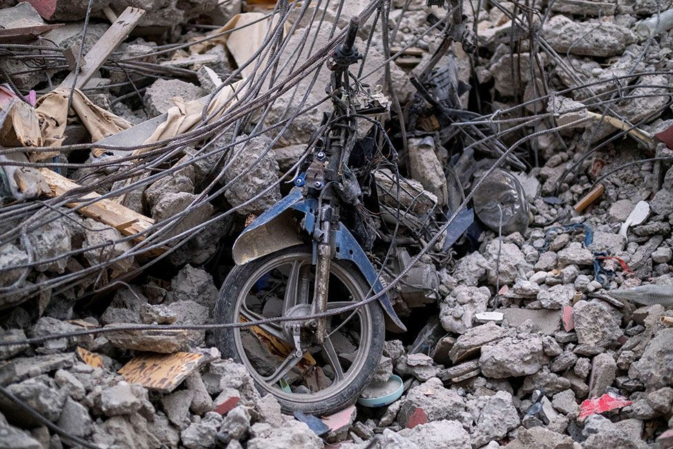 Parts of a motorcycle are seen in the rubble of a destroyed hotel in Les Cayes, Haiti on 16 August 2021