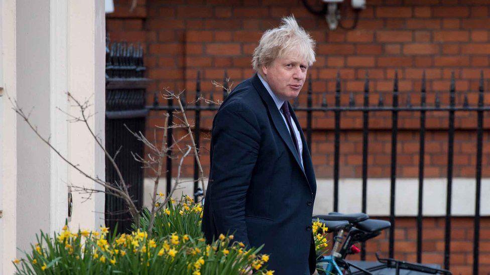 Boris Johnson leaves his house, 22 March