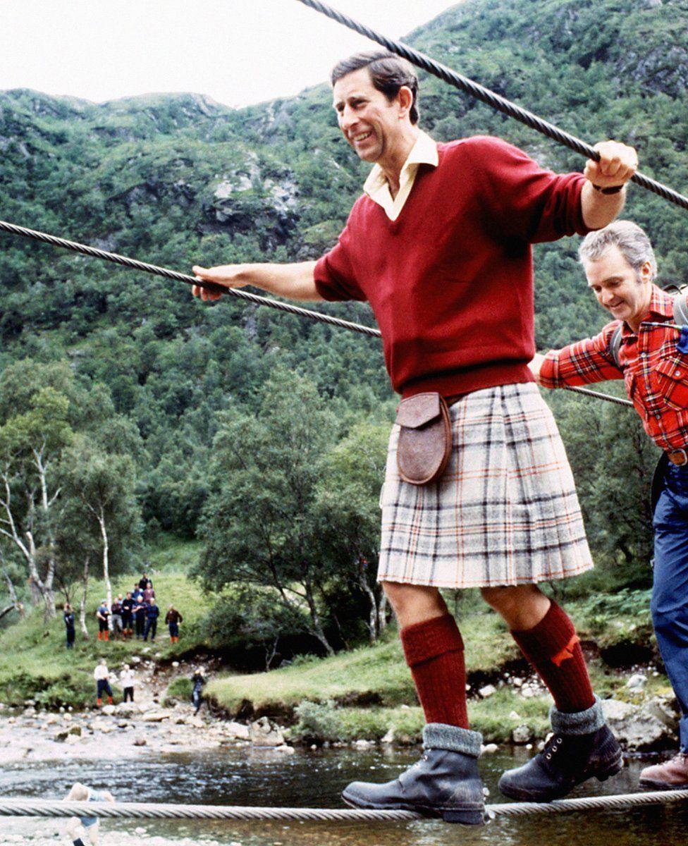 Prince of Wales negotiating a wire bridge
