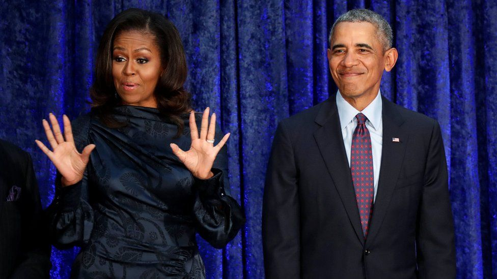 Former US President Barack Obama and former First Lady Michelle Obama react as their portraits are unveiled at Smithsonian's National Portrait Gallery in Washington in February 2018