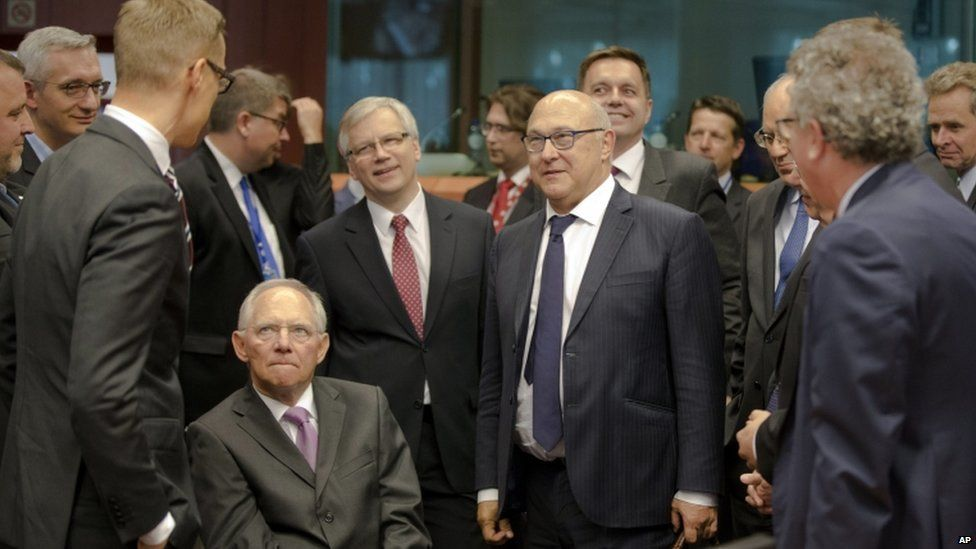 German Finance Minister Wolfgang Schaeuble (centre left) with eurozone counterparts in Brussels, 27 June