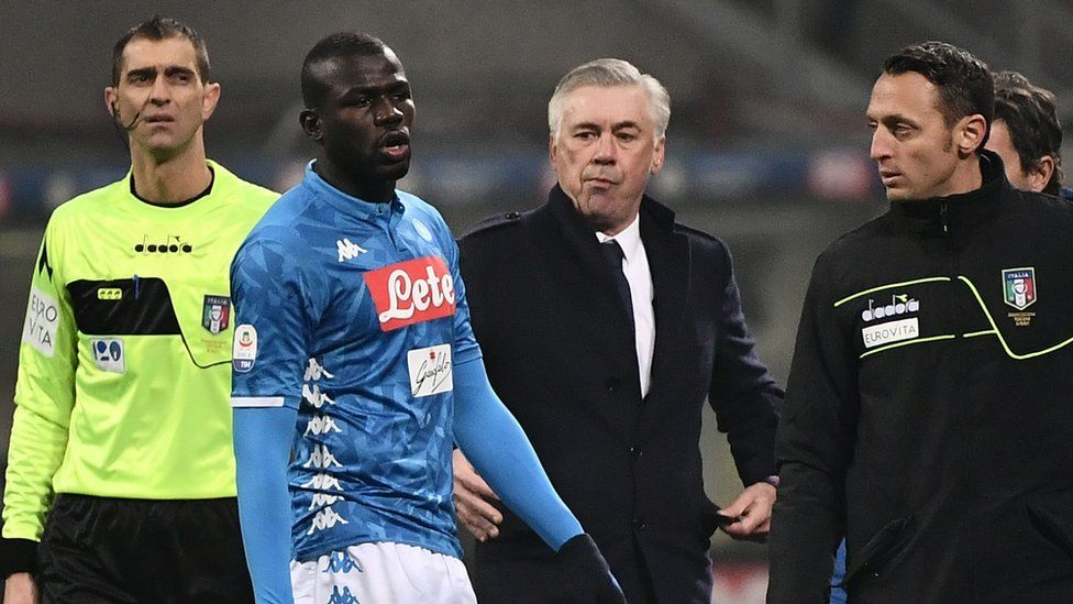 Napoli's Senegalese defender Kalidou Koulibaly (Napoli's) exits the pitch after receiving a red card as Napoli coach Carlo Ancelotti (C) looks on