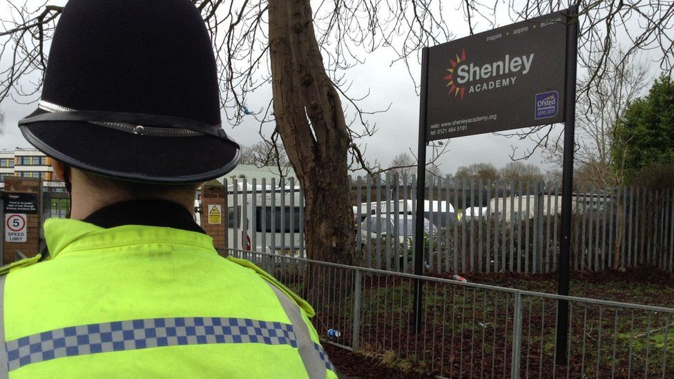 Police officer outside school