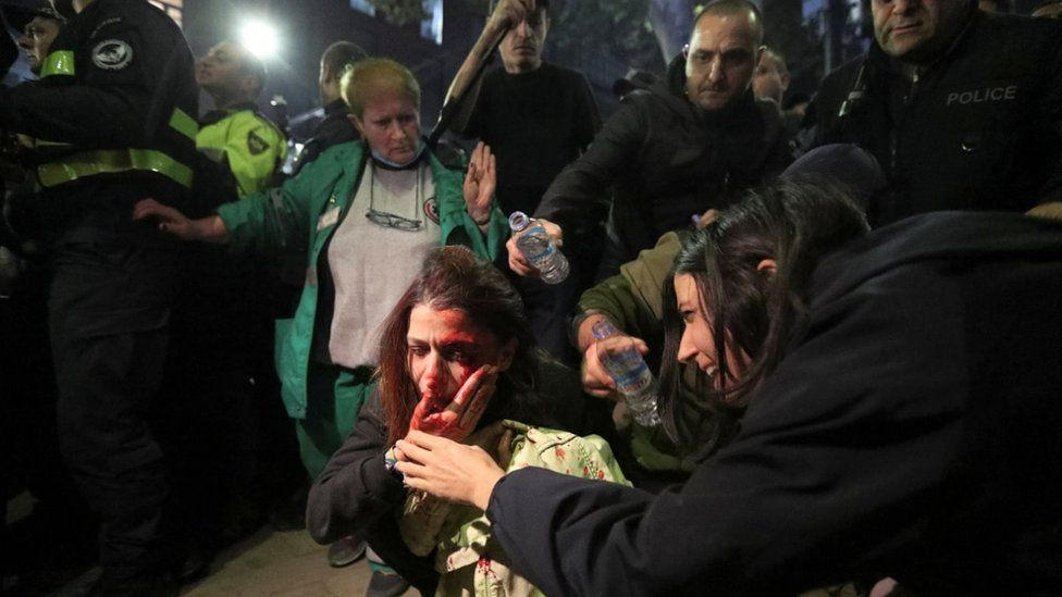 A woman is hurt during an anti-LGBTQ protest in Georgia in November