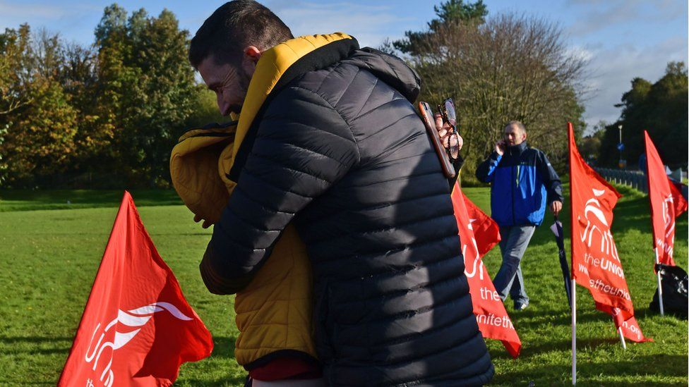 Wrightbus workers hug on hearing news of a deal