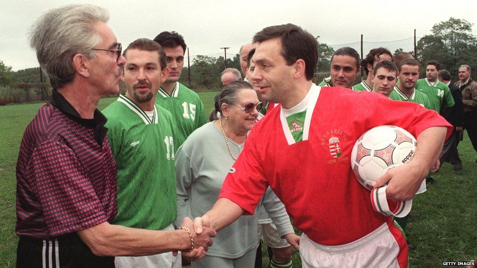 Hungarian Prime Minister Viktor Orban (right) shakes hands with members of the Hungarian American Citizens Club soccer team before playing in a friendly match 10 October 1998