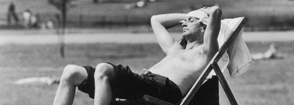 A man sunbathing in Kensington Gardens in the summer of 1976