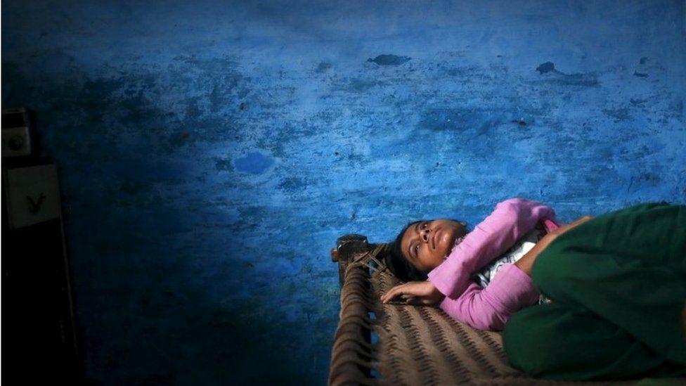 Sajida Saifi, daughter of Akhalaq Saifi, who was killed by a mob, mourns his death inside her house at Bisara village in Uttar Pradesh, India, October 2, 2015
