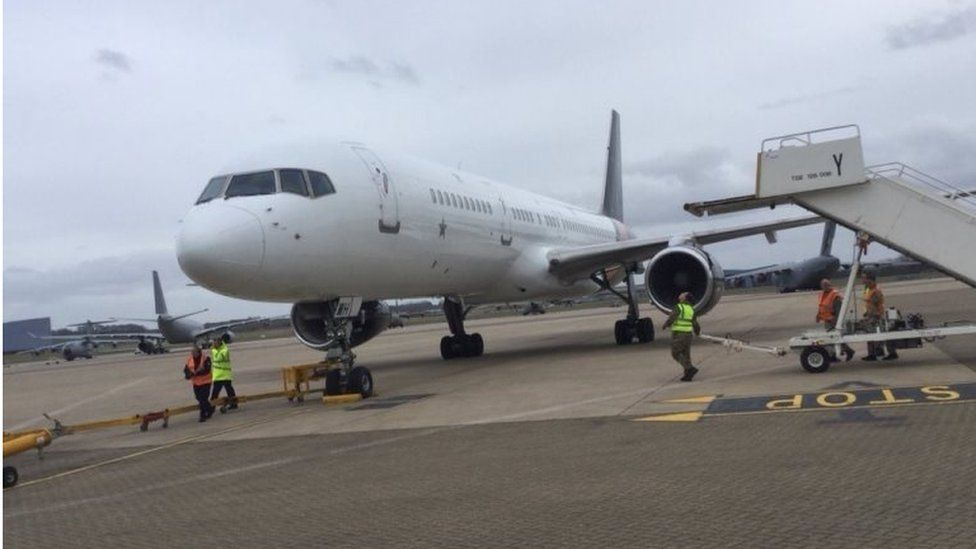 A charter flight from Moscow lands at RAF Brize Norton