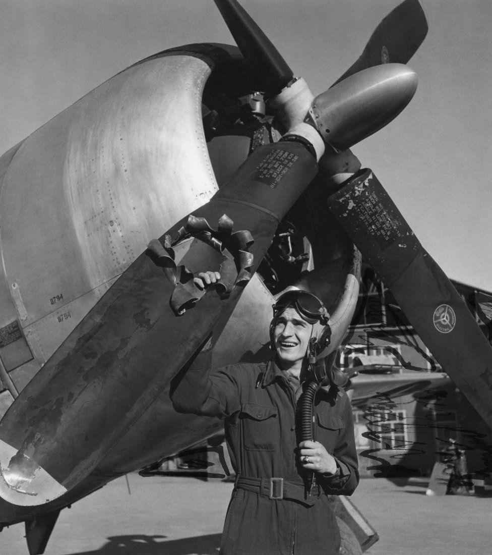 Lt Edwin Wright of the 404th Fighter Group, shows off the damage to his P-47 Thunderbolt, October 1944.