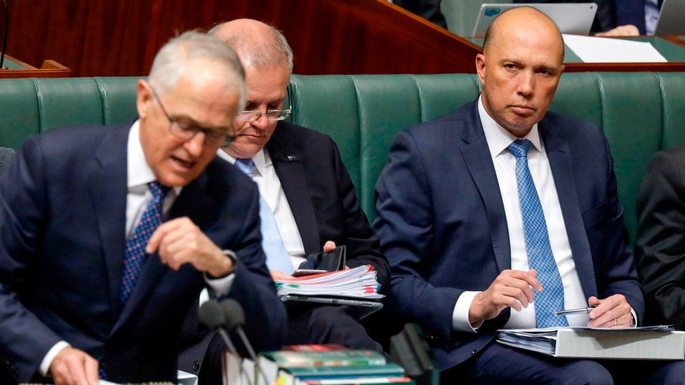 Peter Dutton looks at Malcolm Turnbull in parliament