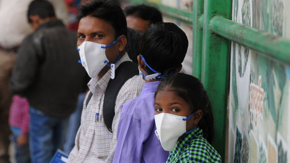 N95 masks to patients with respiratory, lung disease and other high-risk patients at the civil hospital, on November 13, 2017 in Gurgaon, India.