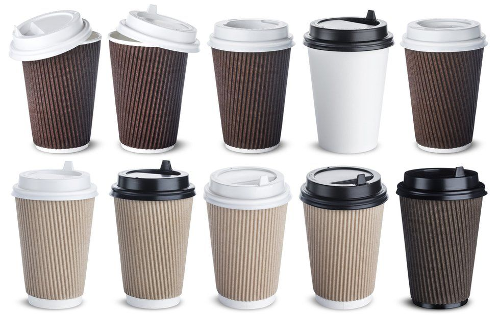 Starbucks coffee to go in a takeaway paper cup on a car