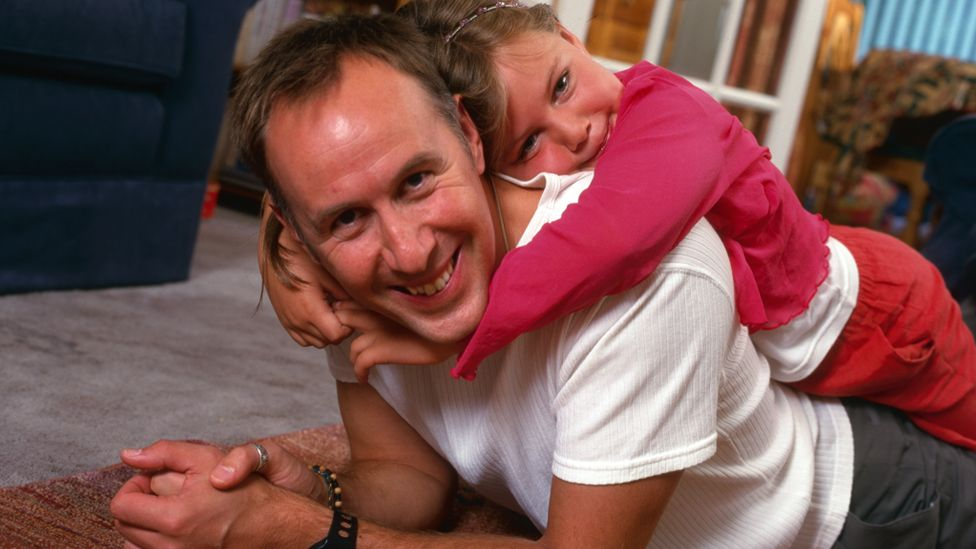 Steve James as a young father with daughter Rose