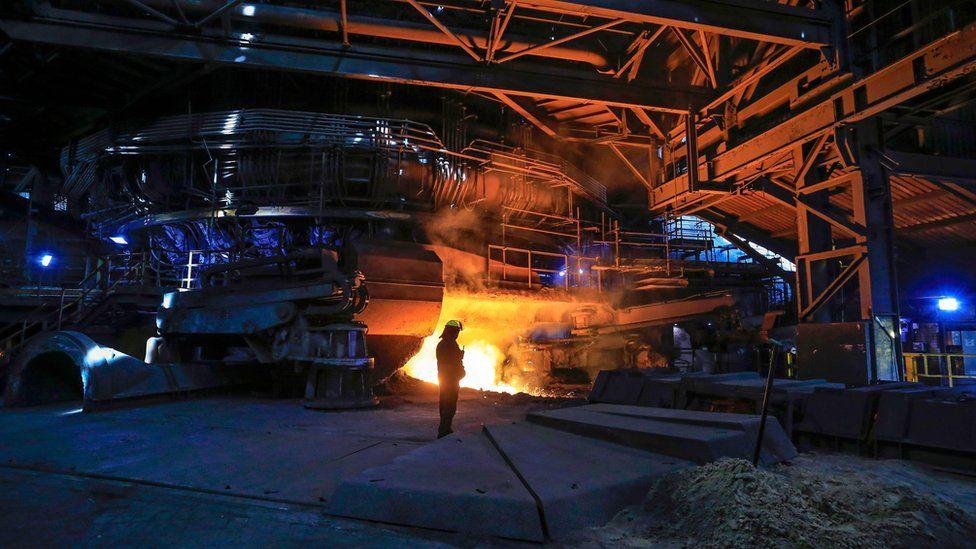 British Steel interior with worker in foreground