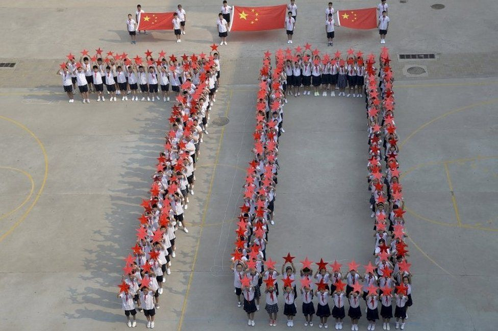 "Students form the figure ""70"" as they pose with Chinese national flags and red stars during a event to mark the 70th anniversary of the Victory of Chinese People""s War of Resistance Against Japanese Aggression and the World Anti-Fascist War, at a primary school in Handan, Hebei province, China, August 31, 2015."