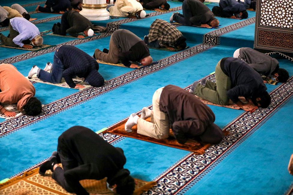 Worshippers praying in a mosque