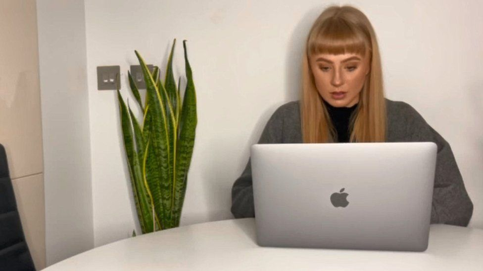 Heather MacFarlane sat at a table with her laptop in front of her