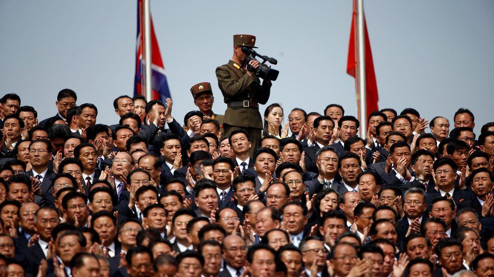 A soldier films the military parade