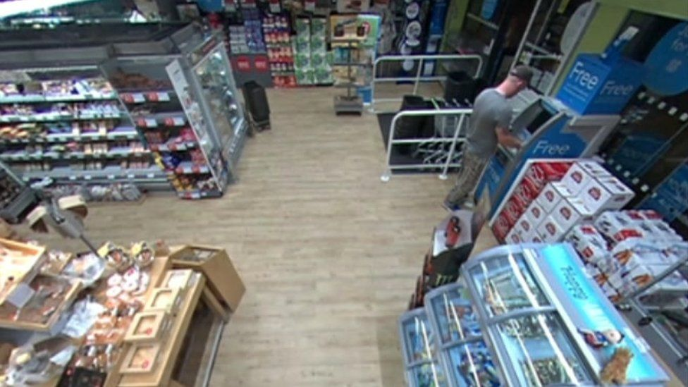 CCTV of Unwin using Ms Nguyen's bank card at a Co-op store
