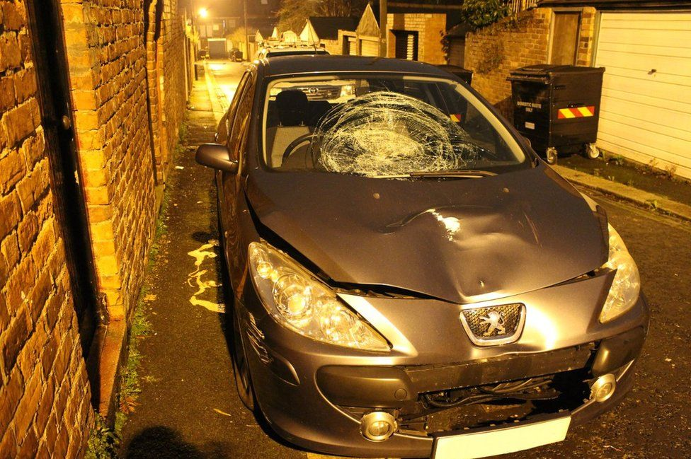 Youssaf's car showing smashed windscreen and bonnet dent
