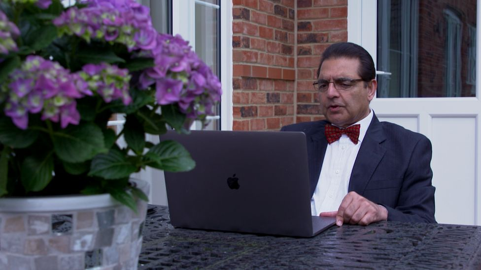 Dr Akhtar connects via video link from his home in Essex