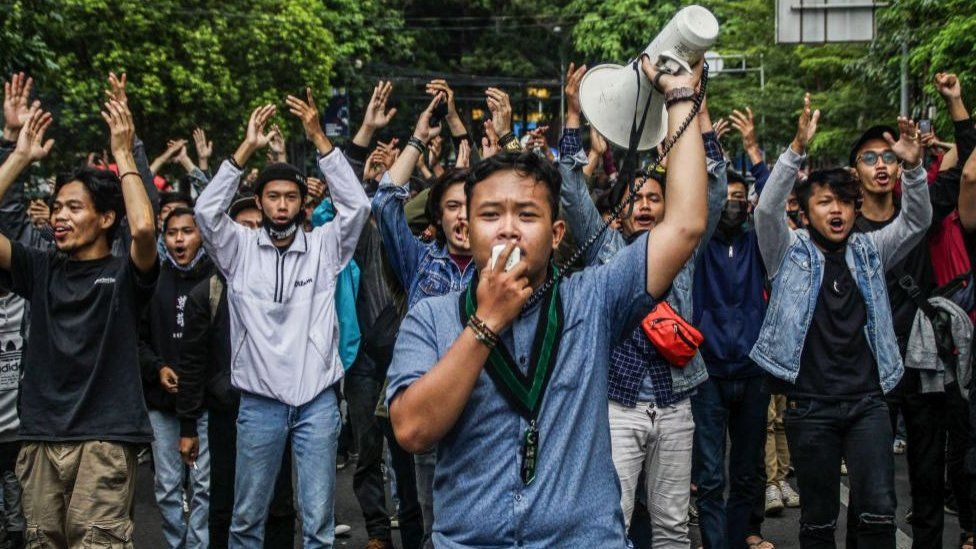 Protestors outside Indonesia's parliament on Tuesday.